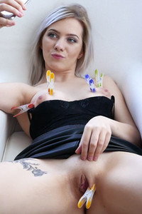 Lustful blonde babe Kate Fresh spreads her legs on the armchair and plays with nippers