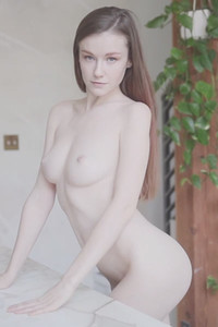 Extremely hot slender beauty seductively poses in her apartment showing off her pale body