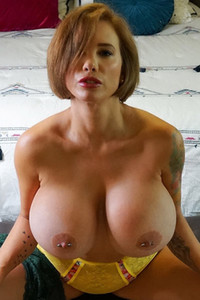 Tattooed young girl lets us see her huge boobs in this amazing solo performance