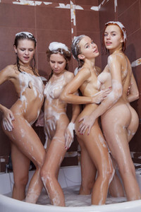 Four unreal young girls are taking a bath together posing and showing off their sexy slim fit bodies