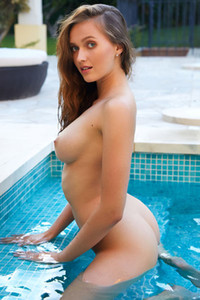 Well stacked brunette Stacy Cruz presents her body in the pool as she flirts with the lens