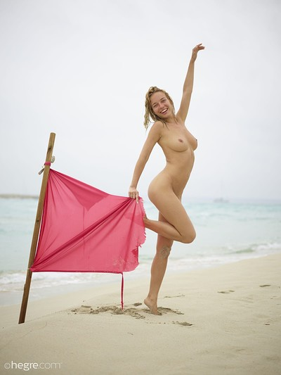 Natalia A in danger on the beach from Hegre Art