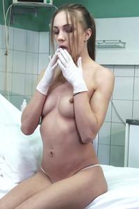 Lustful brunette nurse teases her slender body and makes her pussy wet