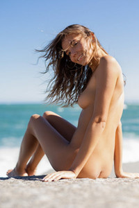 Sweet young brunette Katya Clover easily strips off her clothes and poses naked on the rock