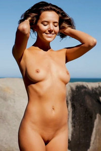Super cute girl puts on the show with amazing naked posing and sunbathing on the rock