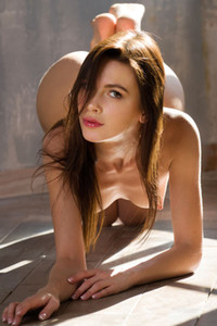 Irresistible brunette vixen gets nude and sways her tanned body in front of the camera
