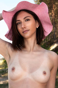 Cute but seductive chick Apricot spends her day outdoors in nature totally naked