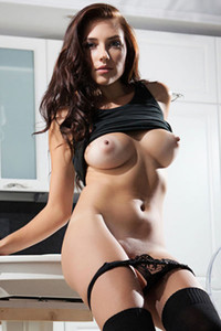 Brunette goddess Niemira takes off her black panties to show us her shaved pussy
