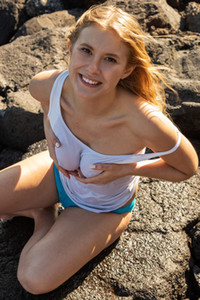 Adorable blondie Casey playfully poses by the sea showing us her nubile body