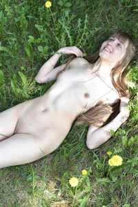 All natural long haired babe Anabel A poses completely naked in nature