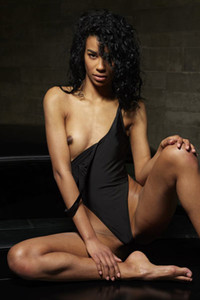 Exotic curly babe takes off her bodysuit to show us her dark tanned body