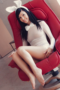 Black haired girl is seducing you by showing her well shaped ass in tight white dress