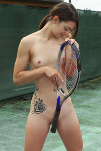 Kinky petite brunette Tera Link poses naked on the tennis court and stuffs her pussy