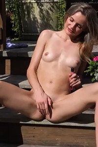 Addee Kate a skinny chick is on the porch stairs masturbating