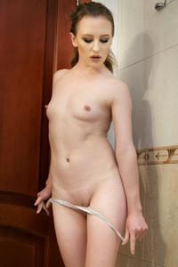 Lustful brunette babe rubs her shaved pussy on the bathroom floor
