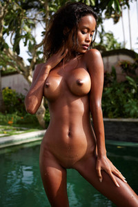 Magnificent ebony hottie presents her smooth body and big tits by the pool