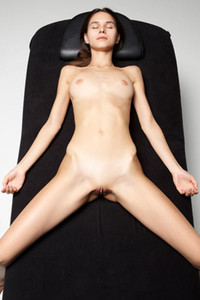 Charming slender doll lays on the massage table showing us her tight pussy
