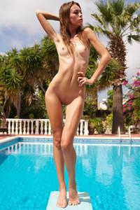 Flirty brunette goddess shows us her slender body by the pool
