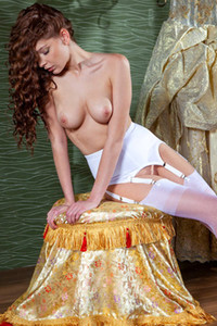 Indiana a glamorous babe in royal dress getting naked in front of the mirror