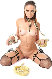 Oxana Chic a babe with blue eyes and hot curves is a queen of snakes
