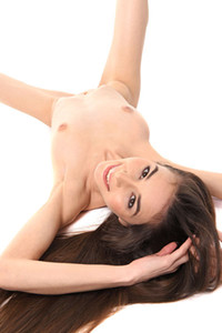 Long haired brunette Leona Mia is seducing you with showing off her body in transparent dress
