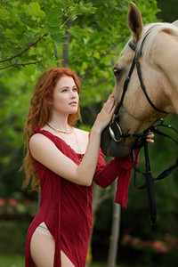 Ginger cutie Heidi Romanova shows off her stunning body while she is walking the horse