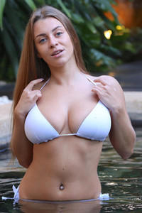 Busty hottie with a tempting look in her eyes Josephine B showing off her huge boobs in the pool