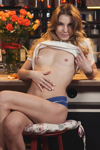 A spectacular little girl in white panties waiting for you in her kitchen ready for your hard tool