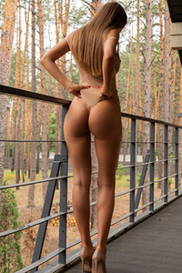 Stunning brunette looks so sexy while she is showing off her big ass in a tight bodysuit