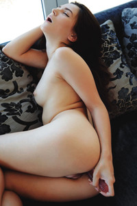 Alluring brunette takes off her pink bodysuit and teases her smooth body