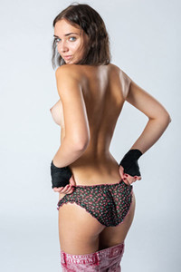 Alluring petite brunette Oxana Chic takes off her sexy panties to show us her peachy ass