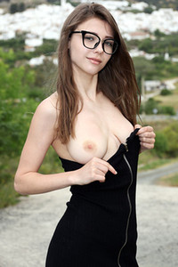 Milla in Undressing Outdoors from Elite Babes