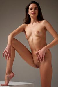 Mesmerizing brunette hottie seductively poses naked in the studio