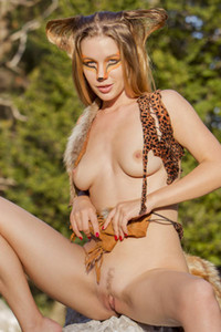 All natural model with nice curves Genevieve Gandi flashing with her assets outdoors in nature