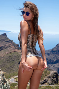 A beautiful hottie Maria is on mountain cliff teasing with her hot ass and shaved pussy
