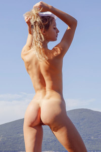 This female sailor simply adores spending her time on the seaside totally naked