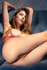 Incredibly hot model Milla getting satisfied on the couch