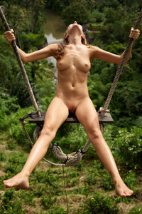All naked and natural brunette Clover enjoying her free time on the big swing