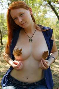 Ginger hottie Petrine Krahlove strips off her shirt and shows off her nice medium boobs