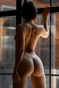 Black short haired girl gives us a nice view of her perfectly shaped ass