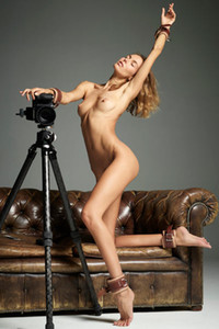 Magnificent slender beauty Alya poses naked as a photographer