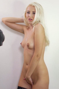 Flirty and playful blondie in stockings strokes her tasty pussy in front of the camera