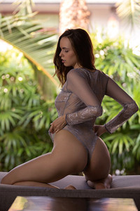 Fantastic young brunette Jana Bubu looks so sexy in tight and transparent bodysuit