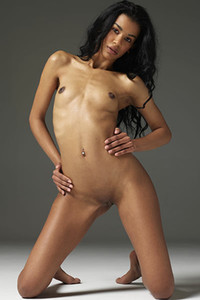 Curly exotic doll Angelique flaunts her beautiful body and pussy in front of the camera