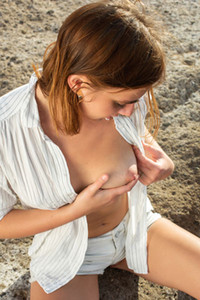 Luscious young babe flaunts her nubile naked body on the beach