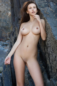 Busty brunette angel Alisa I flaunts her gorgeous tits and meaty ass on the rocks