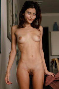 Charming gal Emelia Pearl sprawls her naked body in the living room