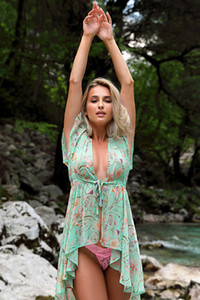 Stunning Cara Mell displays her marvelous figure while posing in nature