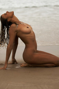 Magnificent doll with braids Jessica Lawson enjoying a hot day at the beach in nude