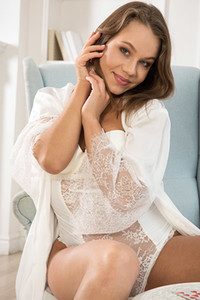 Alluring angel is not feeling shy to get naked and spread her lovely legs for the camera objective